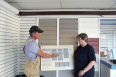 Paul Gonyea shows samples of Gentek vinyl siding to a customer